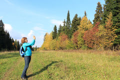 The woman with the camera. The woman with photographing an autumn landscape Royalty Free Stock Photos