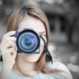 Woman and camera. Stock Image