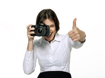 Woman with the camera rejoices to a good shot. Portrait of a beautiful woman taking good shots with camera Stock Images