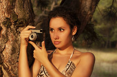 Woman with camera. Retro style. Stock Photo