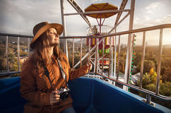Woman with camera ride Ferris wheel Stock Photo