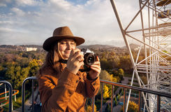 Woman with camera ride Ferris wheel Stock Images