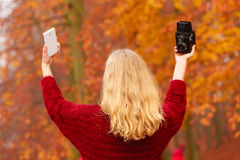 Woman with camera and smartphone take selfie photo Royalty Free Stock Photography