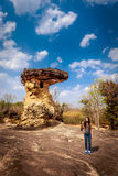 Woman with camera Standing near rock formation Royalty Free Stock Images
