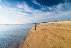 Woman With Camera Standing At Seashore Stock Photo