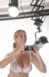 Woman with camera and studio lights Stock Image