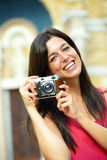 Woman with camera taking photo Stock Image