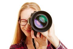 Woman with camera taking pictures Stock Images