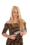 Woman camo dress hold pistol. A woman in her camo dress holding on to a weapon stock photo