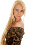 Woman camo dress side looking. A woman in her camo dress looking to the side royalty free stock photo