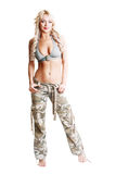 Woman camo pants. Young woman wearing part of an American soldiers uniform camo pants royalty free stock image