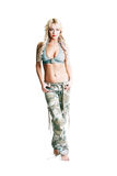 Woman camo pants. Young woman wearing part of an American soldiers uniform camo pants royalty free stock photo