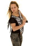 Woman camo pants star shirt gun look back Stock Photography