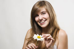 Woman with camomile Stock Photography