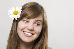 Woman with camomile Royalty Free Stock Photography