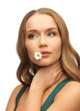 Woman with camomile in mouth Stock Photo
