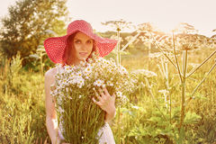 Woman with camomile Stock Photo
