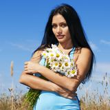 Woman with camomiles Royalty Free Stock Photo