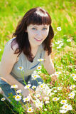 Woman And Camomiles Royalty Free Stock Photos