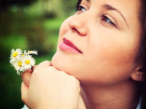 Woman with camomiles Royalty Free Stock Image