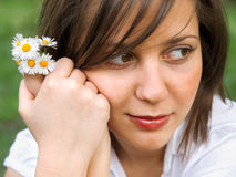 Woman with camomiles Royalty Free Stock Photography