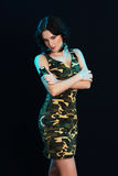 Woman in camouflage dress Stock Photos