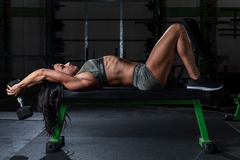 Woman in camouflage outfit working out in a gym Stock Photos