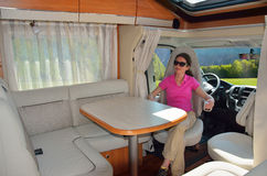 Woman in camper (RV) interior. Family travel and vacation Stock Photo