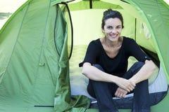 Woman camping stock photo