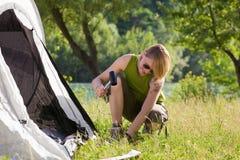 Woman camping Stock Photos
