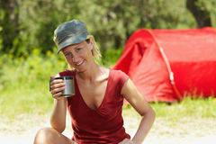 Woman camping Royalty Free Stock Image