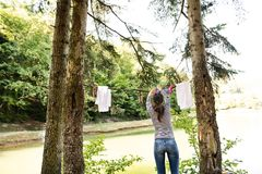 Woman on camping holiday in forest at the lake. royalty free stock photos