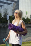 Woman with camping mat Royalty Free Stock Images