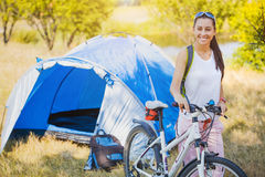 Woman camping in the park Stock Photography