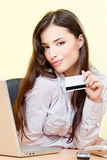 Woman can on line shopping with credit card Royalty Free Stock Photos