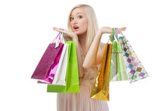 Woman can not choose what to buy Stock Photos