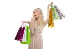 Woman can not choose what to buy Stock Image