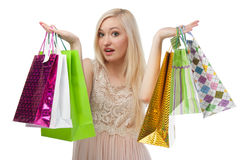 Woman can not choose what to buy Royalty Free Stock Photo