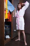 Choose what to wear. Woman can not choose what to wear Stock Images