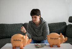 Woman can not decide what to save, holiday or pension stock photos