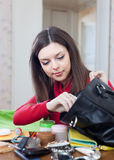 Woman can not finding anything in her purse Royalty Free Stock Photo