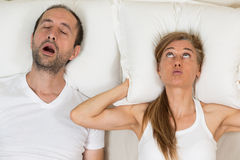 Woman can not sleep. Because of the snoring of her husband Royalty Free Stock Images