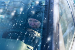 Woman can not start car on cold snowy winter day Royalty Free Stock Photos