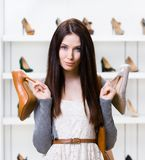 Woman can't choose heeled shoes Stock Photo