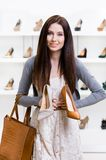 Woman can't choose stylish shoes Stock Photos