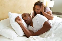 Snoring husband keeping his wife up. Woman can`t sleep because her husband is snoring Royalty Free Stock Image