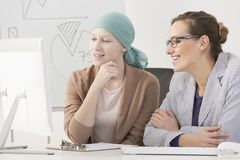 Woman with cancer analyzing statistics Stock Photography