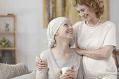 Woman with cancer. Celebrating disease remission with her mother Royalty Free Stock Photo