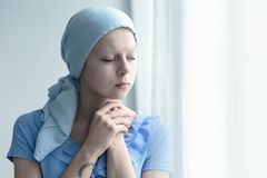 Woman with cancer praying. Married woman with cancer faithfully praying for miracle of healing royalty free stock photo