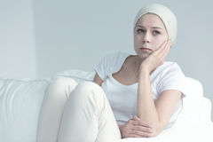 Woman with cancer sitting royalty free stock images